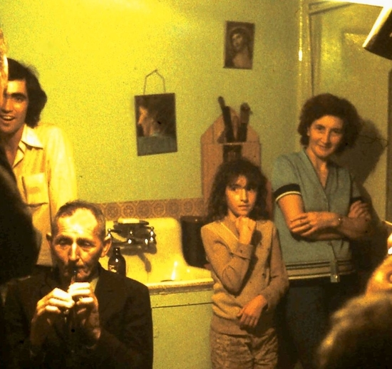 Frankie Nash plays the whistle in the Roche's house, Branch, Newfoundland, ca. 1976/77 / Aidan O'Hara