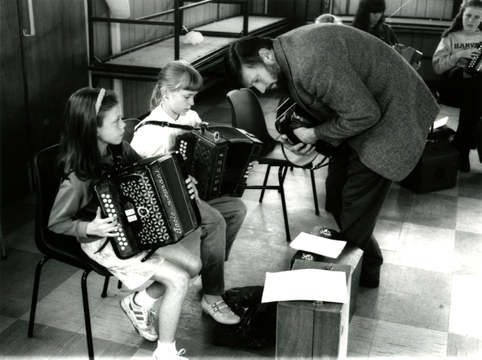 Charlie Harris, accordion, with unidentified students / Tony Kearns
