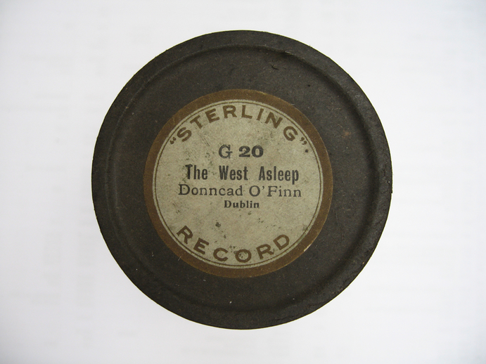 Sterling cylinder lid.  The West asleep : Donncad O'Finn / Henri Chamoux