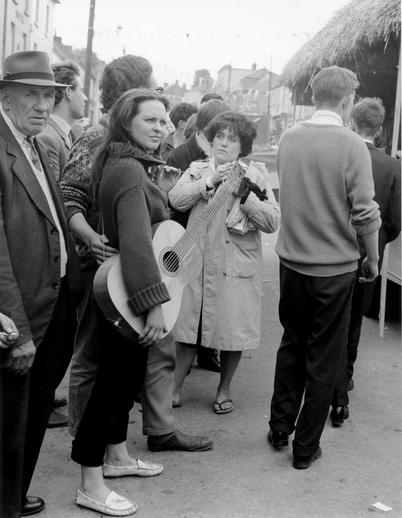Woman with guitar at the Fleadh Cheoil, Gorey, 1962 / Bord Fáilte