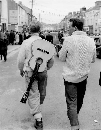 Man with guitar at the Fleadh Cheoil, Gorey, 1962 / Bord Fáilte
