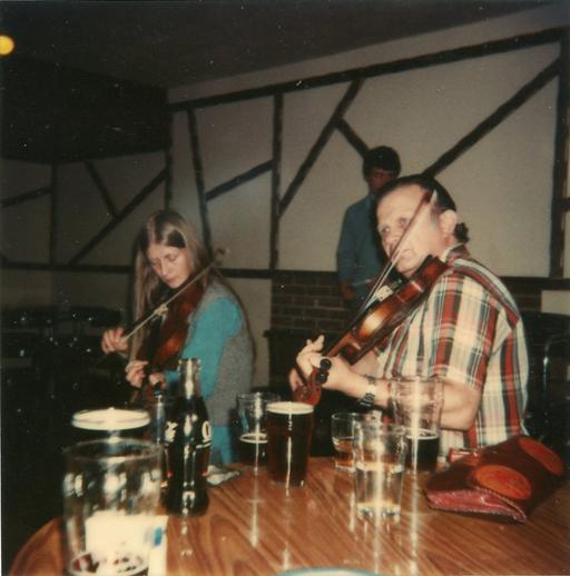 Mairéad Ní Mhaonaigh and Proinsias Ó Maonaigh, fiddles / [unidentified photographer]