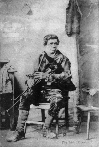 Unidentified piper seated indoors / [unidentified photographer]