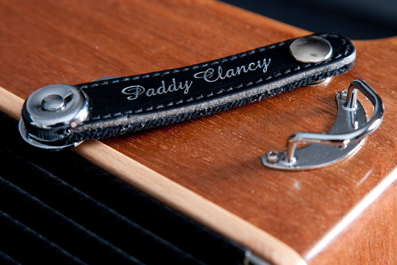 Leather accordion strap embossed with the name Paddy Clancy / Stephen Power
