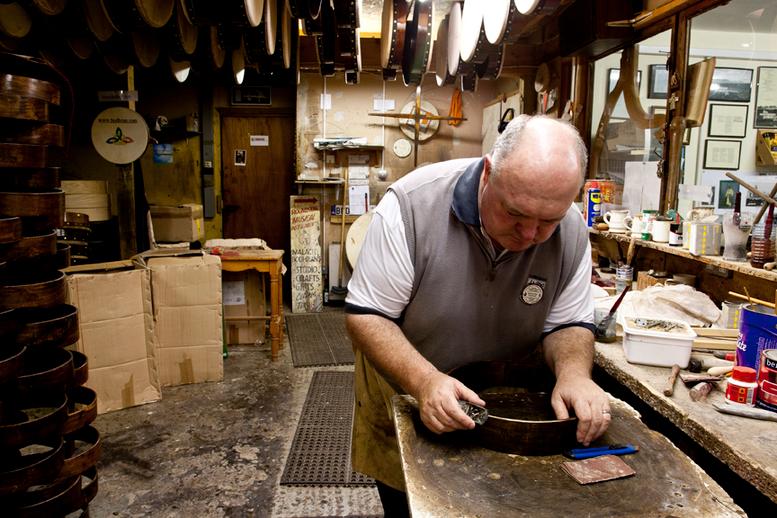 Bodhran maker Malachy Kearns making bodhran rim / Stephen Power