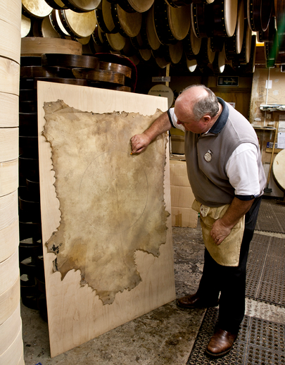 Bodhran maker Malachy Kearns marking on goatskin / Stephen Power