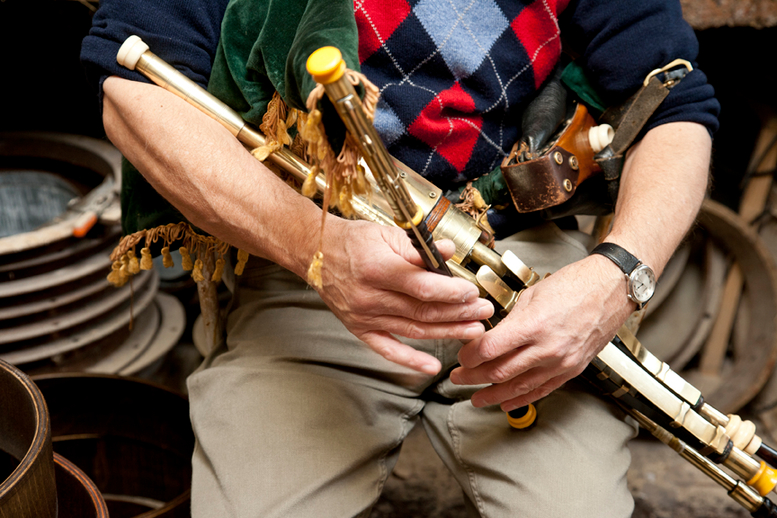 Uilleann pipe maker Michael Vignoles playing a set of his own pipes / Stephen Power