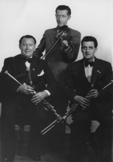James Quinn, uilleann pipes, & others, 1950s / unidentified photographer
