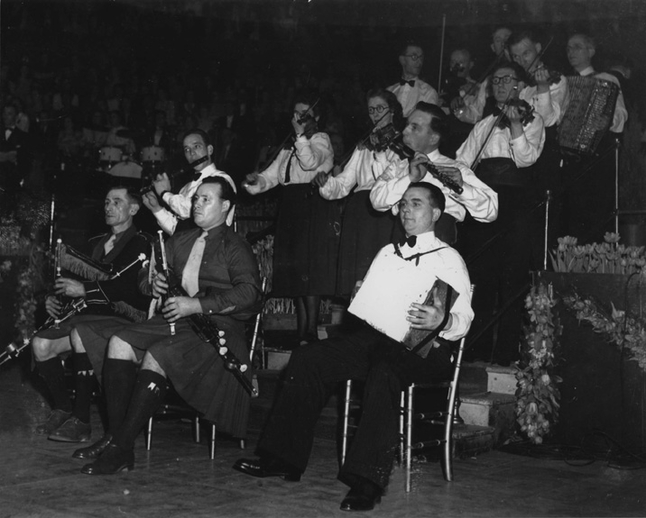 James Quinn, uilleann pipes, & others, c. 1958  / unidentified photographer