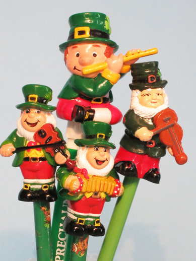 Four pencil toppers featuring leprechauns playing traditional instruments / ITMA photographer