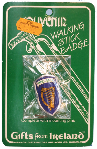 Walking stick badge featuring a harp / ITMA photographer