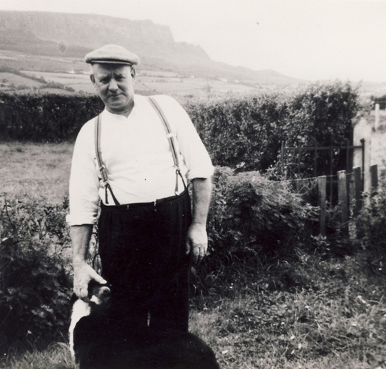 Eddie Butcher with his dog Mac, c. 1975 / Evelyn Mullen (née Butcher)