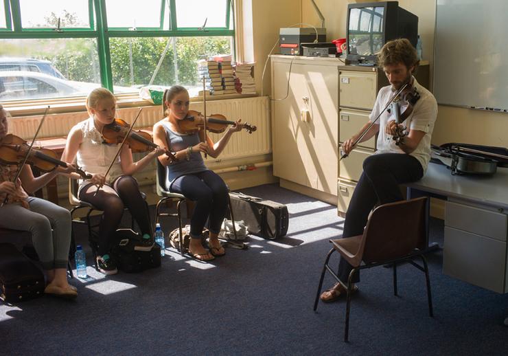Caoimín Ó Raghallaigh with his fiddle students / Tony Kearns