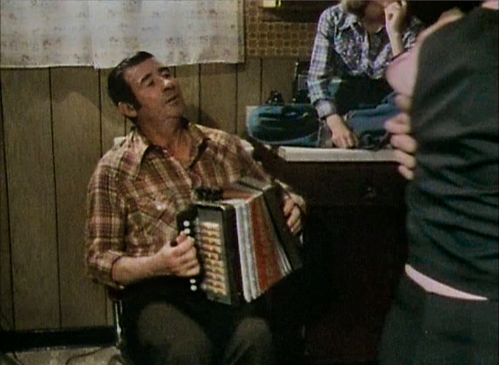 Gerald Campbell playing the accordion for dancers, August 1980 / The Radharc Trust Film Archive