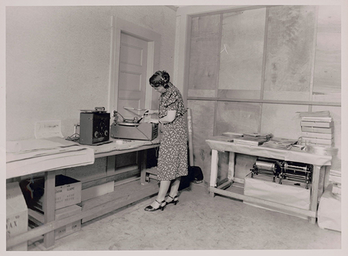 Sidney Robertson Cowell copying California Folk Music Project recordings for the Library of Congress in the project office on Shattuck Avenue, Berkeley, California, in early 1939, courtesy of the American Folklife Center  / [unidentified photographer]