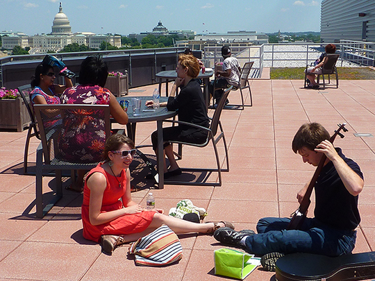 Summer interns Katie Ortiz and Max Smith on the roof of the Center for Folklife and Cultural Heritage at the Smithsonian Institute, home of the Rinzler Archives, with the US Capitol and Library of Congress in the distance / Deirdre Ní Chonghaile