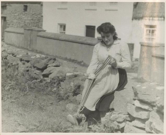 Renowned knitter Máirín Thomáis Uí Dhomhnaill née Ní Chonghaile (1934-2020) making a crios [woven textile belt], Inis Meáin, August 1956, courtesy of the American Folklife Center, Library of Congress / Sidney Robertson Cowell