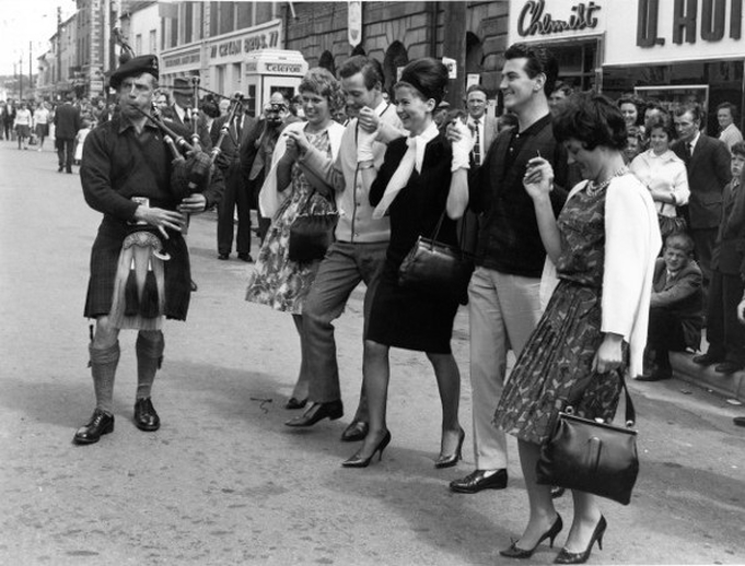 Piper and dancers at the Fleadh Cheoil, Gorey, 1962 / Bord Fáilte