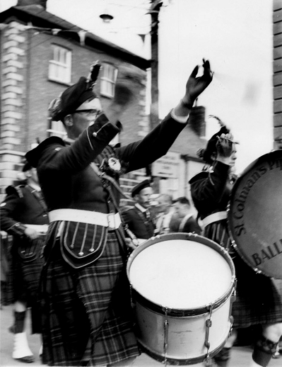 St. Colman's Pipe Band at the Fleadh Cheoil, Gorey, 1962 / Bord Fáilte
