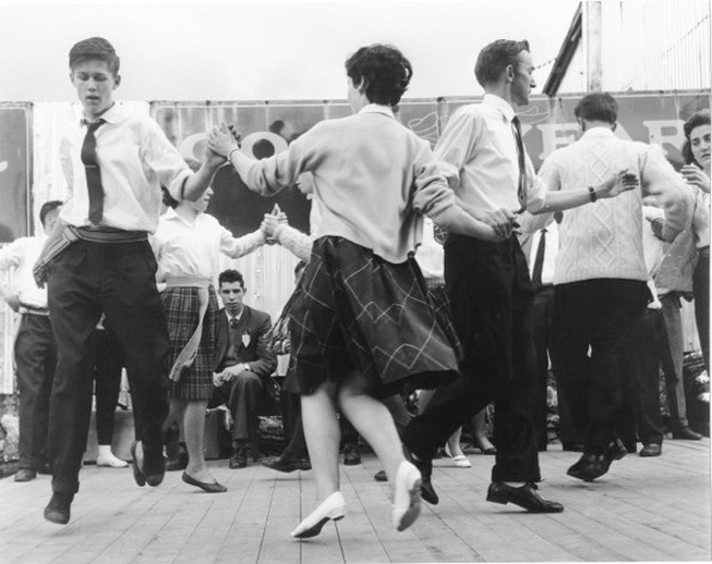 Group of men and women dancing on stage at the Fleadh Cheoil, Gorey, 1962 / Bord Fáilte