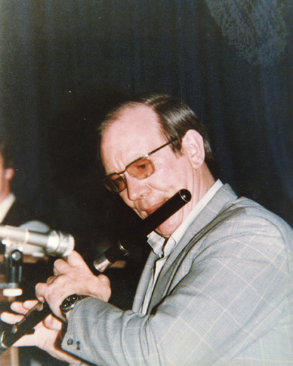 Mick Hand, flute / [unidentified photographer]