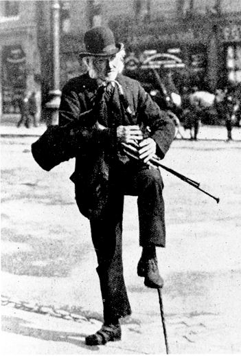 Unidentified piper playing on street / [unidentified photographer]
