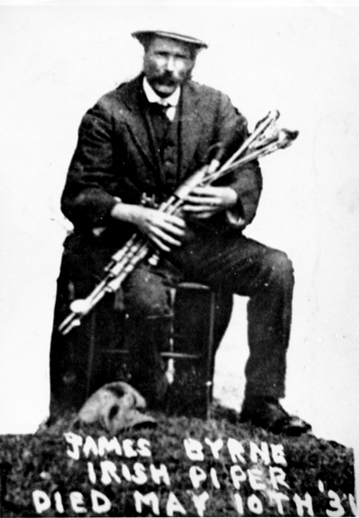 James Byrne seated and holding pipes / [unidentified photographer]
