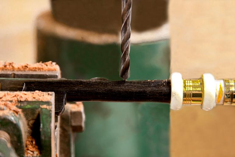 Drilling on a chanter in uilleann pipe maker Michael Vignoles' workshop / Stephen Power