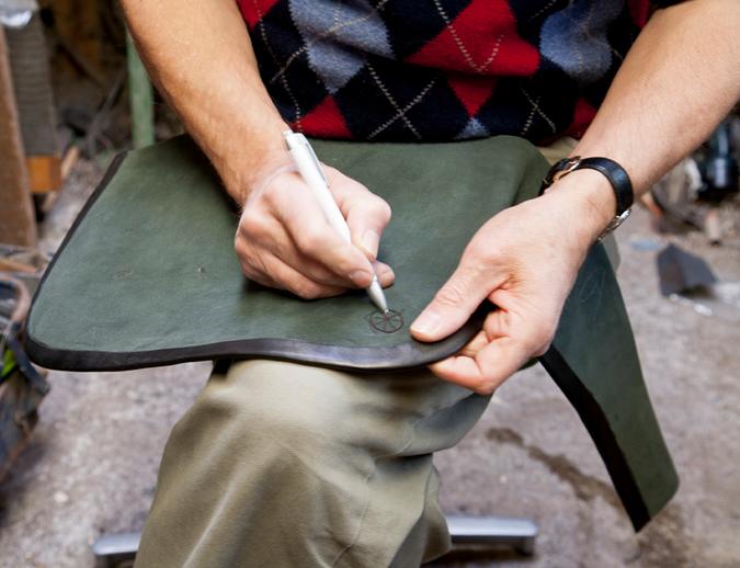 Uilleann pipe maker Michael Vignoles marking on leather / Stephen Power