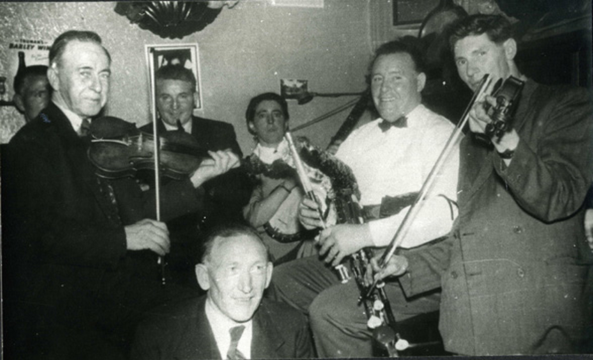 James Quinn, uilleann pipes, & others, c. 1957 / unidentified photographer