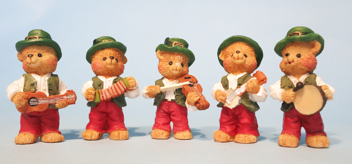Five ceramic bears playing traditional instruments / ITMA photographer