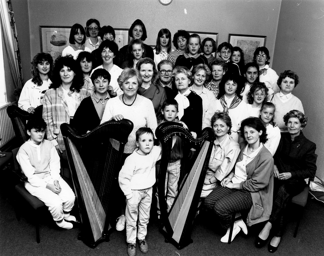 Gráinne Yeats with participants and tutors at Downpatrick harp weekend / [unidentified photographer]