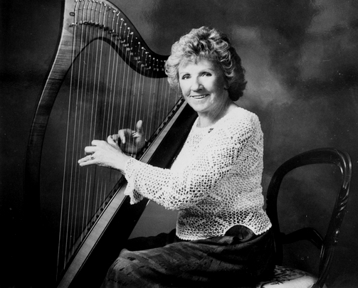Gráinne Yeats seated at harp / [unidentified photographer]